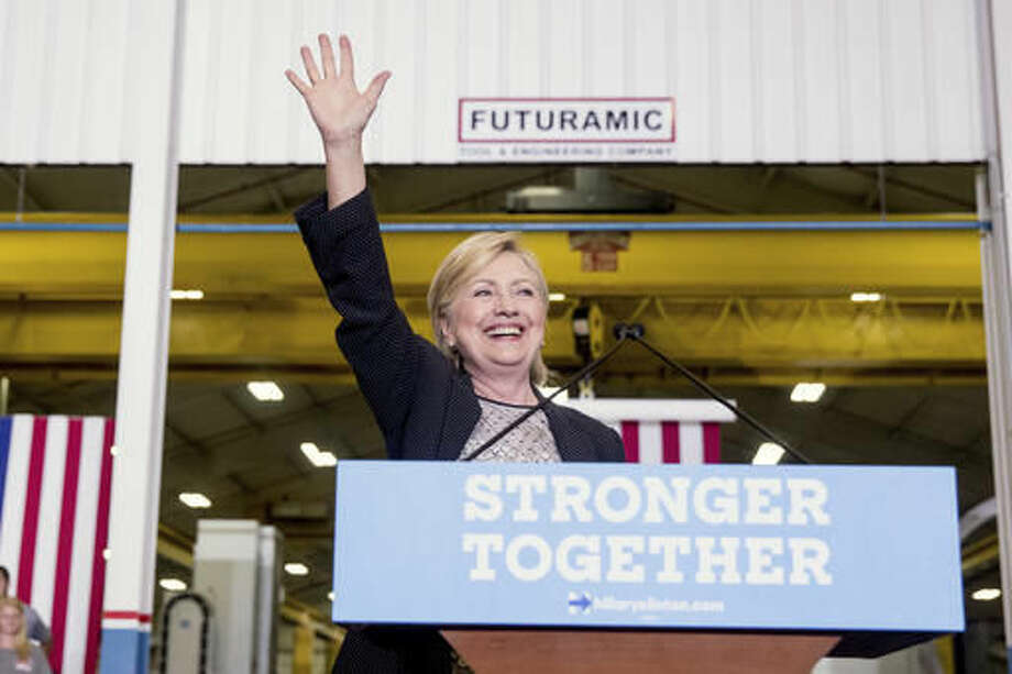 Democratic presidential candidate Hillary Clinton waves as she finishes a speech on the economy after touring Futuramic Tool & Engineering, in Warren, Mich., Thursday, Aug. 11, 2016. (AP Photo/Andrew Harnik) Photo: Andrew Harnik