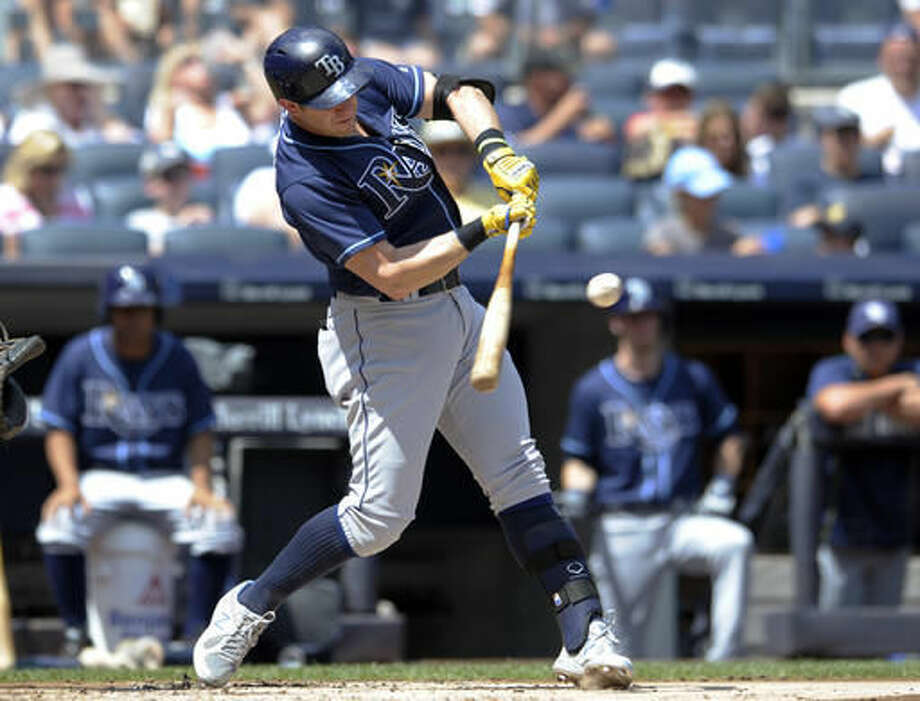Tampa Bay Rays' Evan Longoria hits an RBI double during the first inning of a baseball game against the New York Yankees on Sunday, Aug.14, 2016, at Yankee Stadium in New York. (AP Photo/Bill Kostroun) Photo: Bill Kostroun