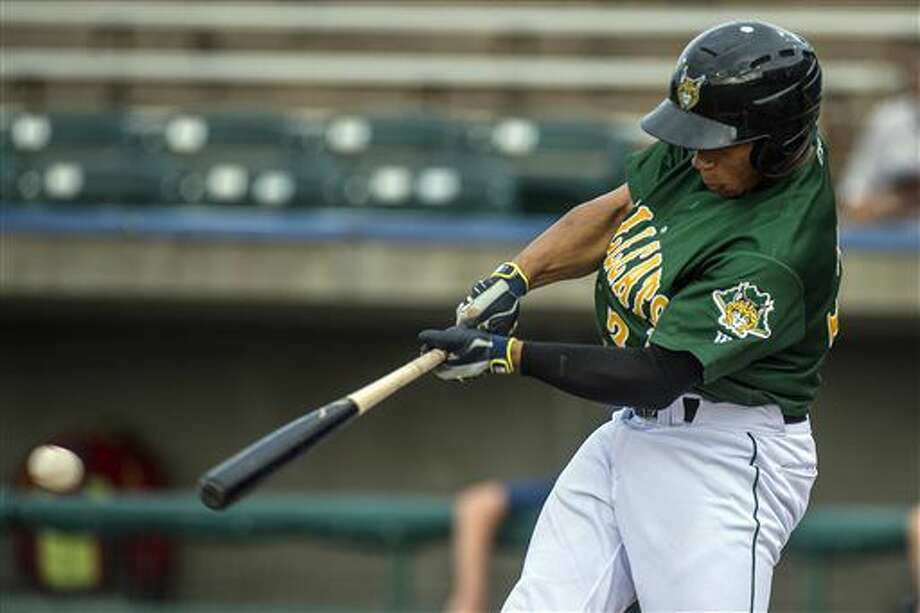 In this Monday, Aug, 1, 2016, photo, Lynchburg Hillcats' Francisco Mejia hits a single, extending his hitting streak to 43 games, during the first inning of a minor league baseball against the Potomac Nationals in Lynchburg, Va. The Cleveland Indians catching prospect is a modern-day Joe DiMaggio riding a 48-game hitting streak, that ranks as the eighth-longest in baseball history and the longest since 1954. (Lathan Goumas/News & Daily Advance via AP) Photo: Lathan Goumas