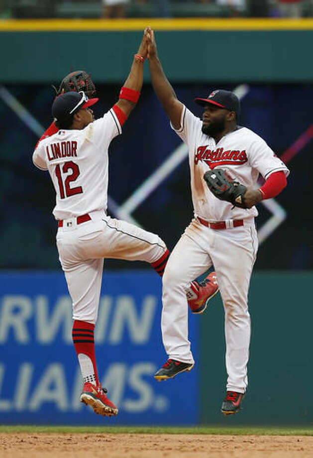 Cleveland Indians' Francisco Lindor (12) and Abraham Almonte celebrate the team's 5-4 win against the Los Angeles Angels in a baseball game Sunday, Aug. 14, 2016, in Cleveland. (AP Photo/Ron Schwane) Photo: Ron Schwane