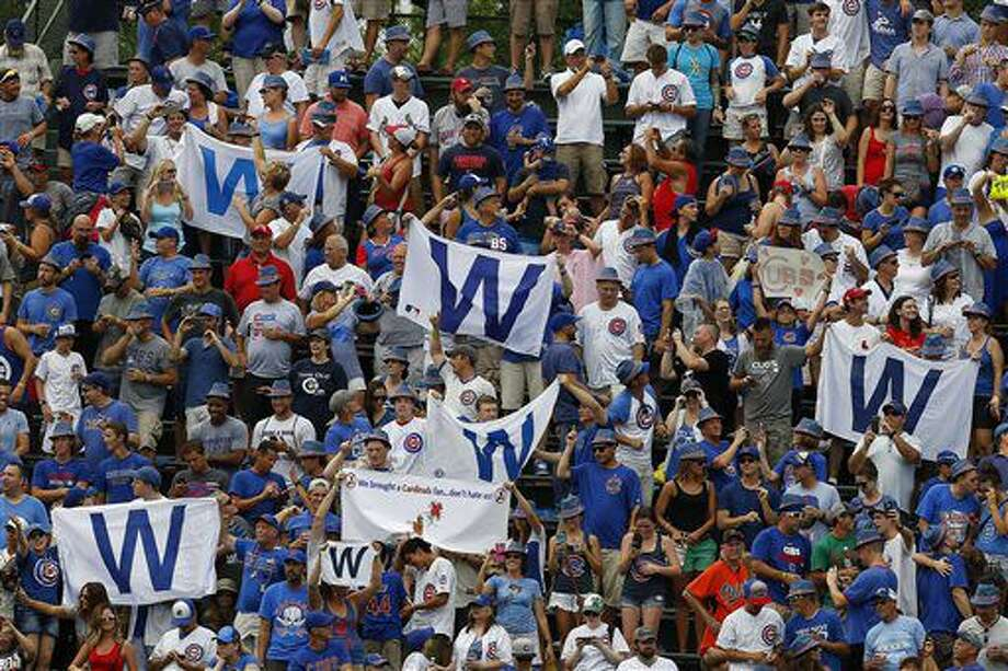 Fans fly their W flags as the Chicago Cubs defeated the St. Louis Cardinals 13-2 in a baseball game Friday, Aug. 12, 2016, in Chicago. (Brian Hill/Daily Herald via AP) Photo: Brian Hill