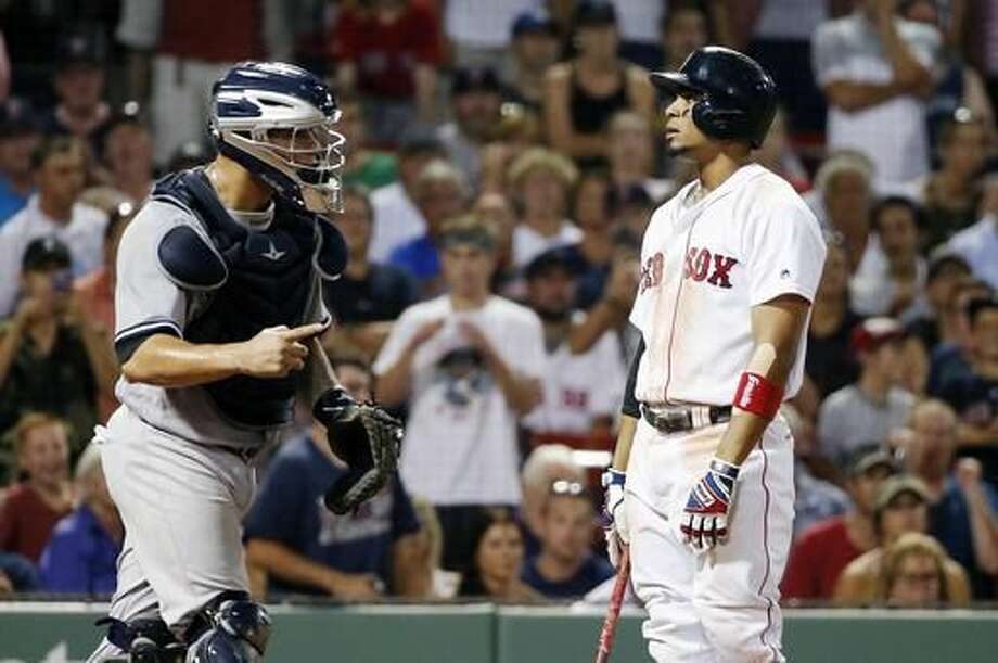 Boston Red Sox's Xander Bogaerts, right, stands at the plate after striking out to end the baseball game, as New York Yankees' Gary Sanchez, left, signals to teammate Dellin Betances, Thursday, Aug. 11, 2016, in Boston. The Yankees won 4-2. (AP Photo/Michael Dwyer) Photo: Michael Dwyer