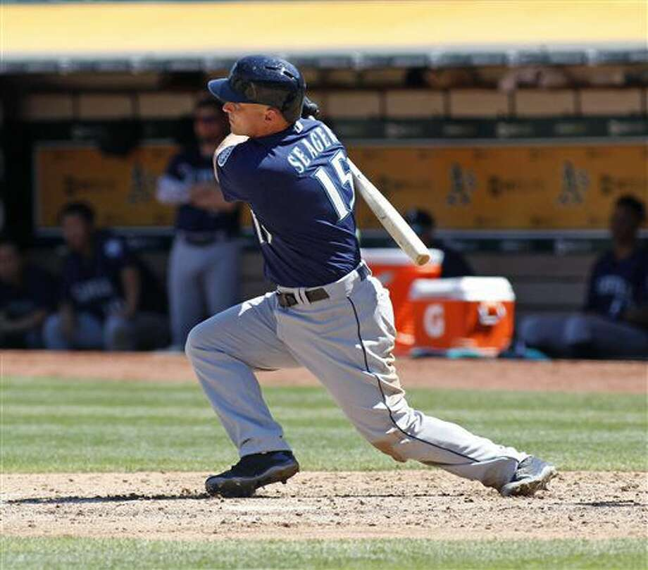 Seattle Mariners' Kyle Seager hits a three RBI-double against the Oakland Athletics during the sixth inning of a baseball game, Sunday, Aug. 14, 2016, in Oakland, Calif. (AP Photo/George Nikitin) Photo: George Nikitin