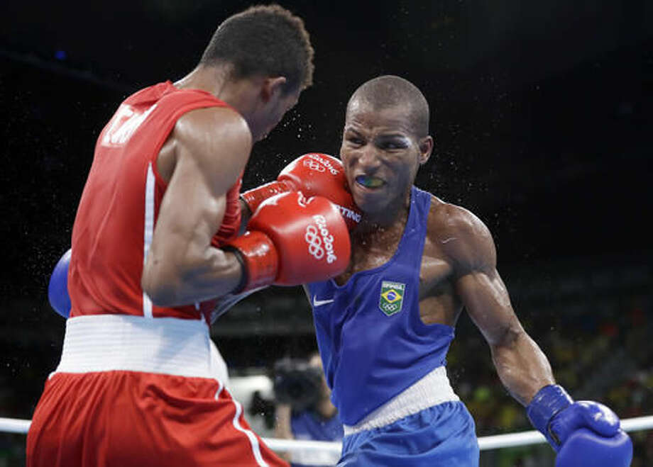 Brazil's Robson Conceicao, right, and Cuba's Lazaro Jorge Alvarez exchange punches during a men's lightweight 60-kg semifinals boxing match at the 2016 Summer Olympics in Rio de Janeiro, Brazil, Sunday, Aug. 14, 2016. (AP Photo/Frank Franklin II) Photo: Frank Franklin II