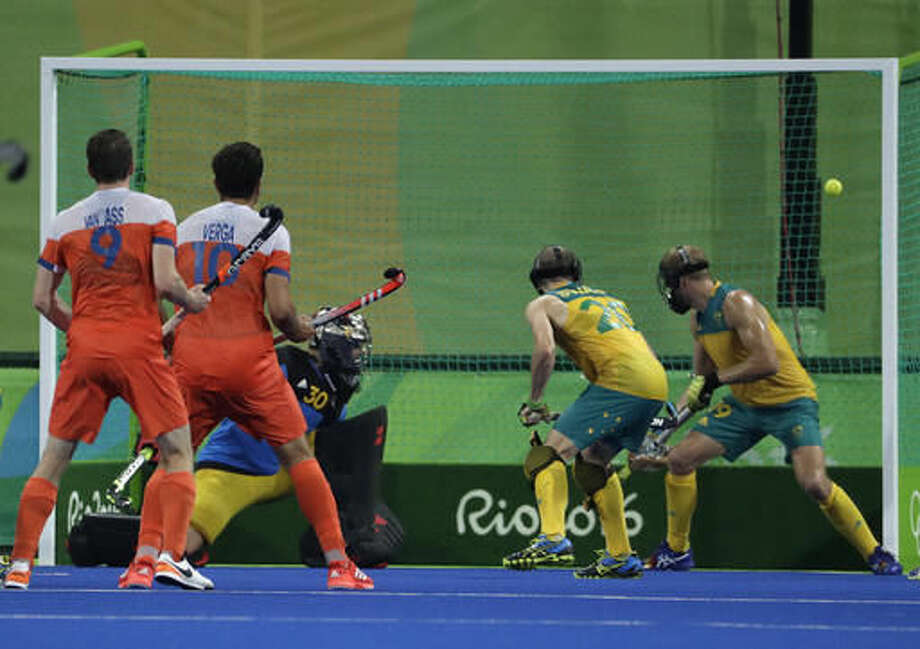 Australian players Mathew Swann and his teammate Bob da Voogd, right, look to a scored ball enter their net during a men's field hockey quarterfinal match against Netherlands at 2016 Summer Olympics in Rio de Janeiro, Brazil, Sunday, Aug. 14, 2016. (AP Photo/Hussein Malla) Photo: Hussein Malla