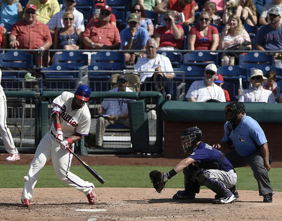 Philadelphia Phillies' Jimmy Paredes connects for an RBI double during the fifth inning of a baseball game against the Colorado Rockies on Sunday, Aug. 14, 2016, in Philadelphia. The Phillies won 7-6. (AP Photo/Michael Perez) Photo: Michael Perez