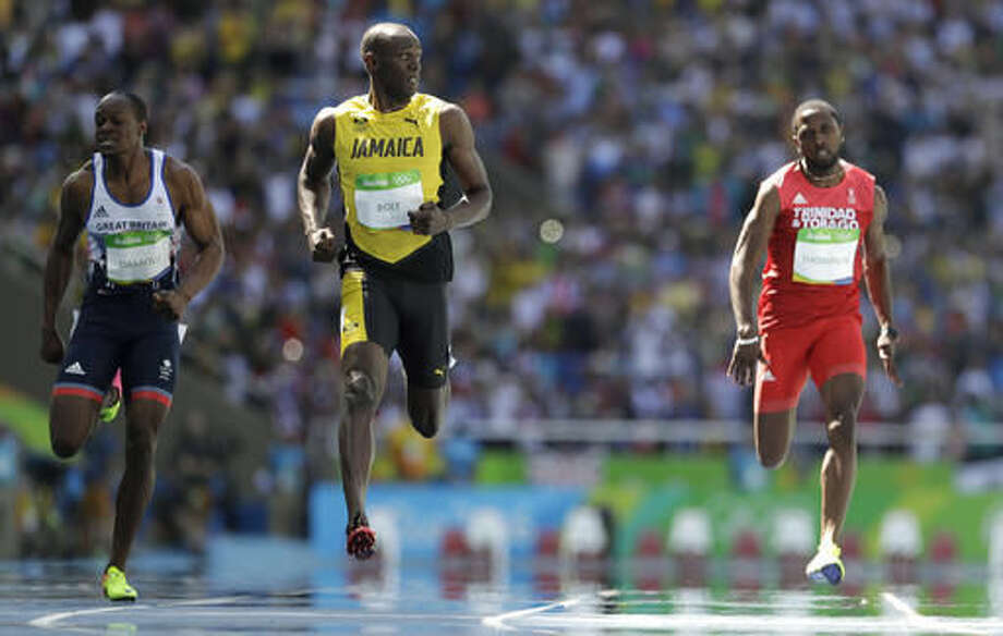 Jamaica's Usain Bolt, center, Trinidad and Tobago's Richard Thompson, right, and Britain's James Dasaolu compete in a men's 100-meter heat during the athletics competitions of the 2016 Summer Olympics at the Olympic stadium in Rio de Janeiro, Brazil, Saturday, Aug. 13, 2016. (AP Photo/David J. Phillip) Photo: David J. Phillip