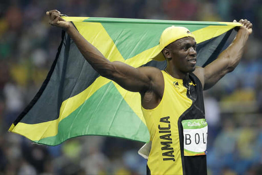 Jamaica's Usain Bolt celebrates after winning gold in the men's 100-meter final during the athletics competitions of the 2016 Summer Olympics at the Olympic stadium in Rio de Janeiro, Brazil, Sunday, Aug. 14, 2016. (AP Photo/David Goldman) Photo: David Goldman