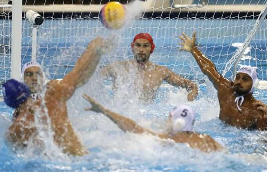 Hungary's Norbert Hosnyanszky shoots and scores against Brazil during men's water polo preliminary round match at the 2016 Summer Olympics in Rio de Janeiro, Brazil, Sunday, Aug. 14, 2016. (AP Photo/Sergei Grits) Photo: Sergei Grits