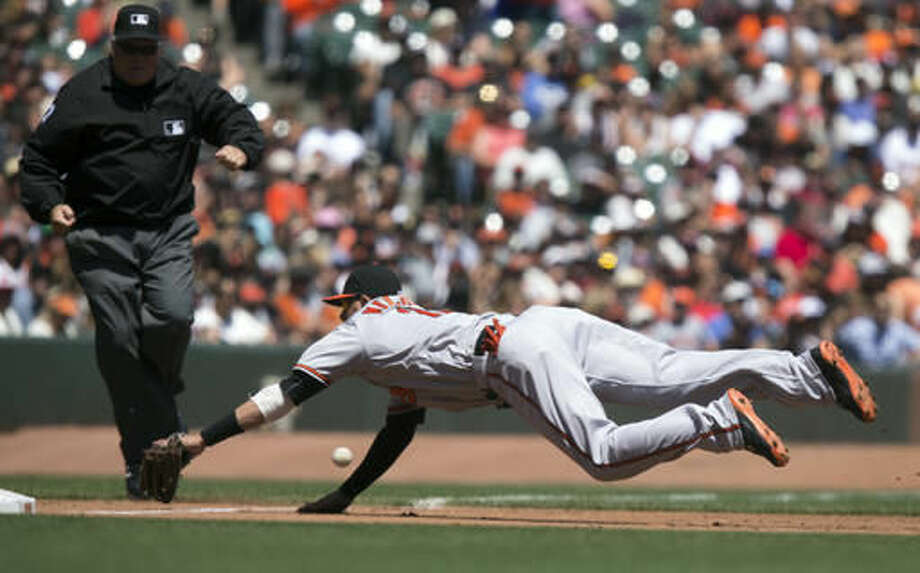 Baltimore Orioles third baseman Manny Machado dives in vain for a double down the line by San Francisco Giants' Angel Pagan during the third inning of a baseball game, Sunday, Aug. 14, 2016, in San Francisco. The umpire is Brian O'Nora. (AP Photo/D. Ross Cameron) Photo: D. ROSS CAMERON