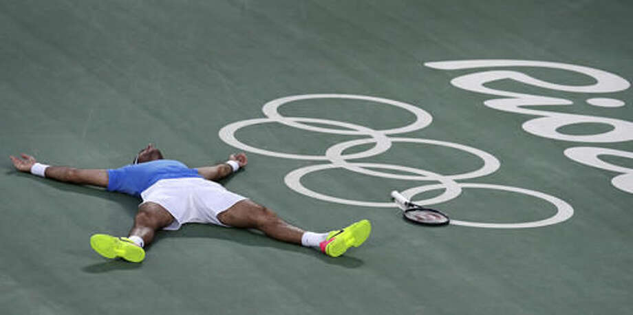Juan Martin del Potro, of Argentina, drops to the court as he celebrates his victory over Rafael Nadal, of Spain, during their semi-final round match at the 2016 Summer Olympics in Rio de Janeiro, Brazil, Saturday, Aug. 13, 2016. (AP Photo/Charles Krupa) Photo: Charles Krupa