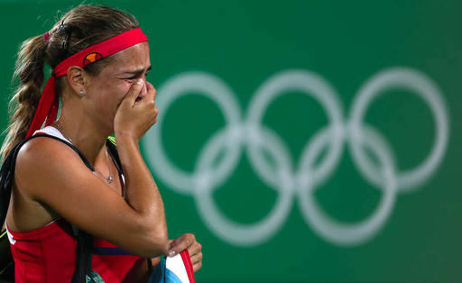 Monica Puig of Puerto Rico cries after winning the gold medal match in the women's tennis competition at the 2016 Summer Olympics in Rio de Janeiro, Brazil, Saturday, Aug. 13, 2016. (AP Photo/Vadim Ghirda) Photo: Vadim Ghirda