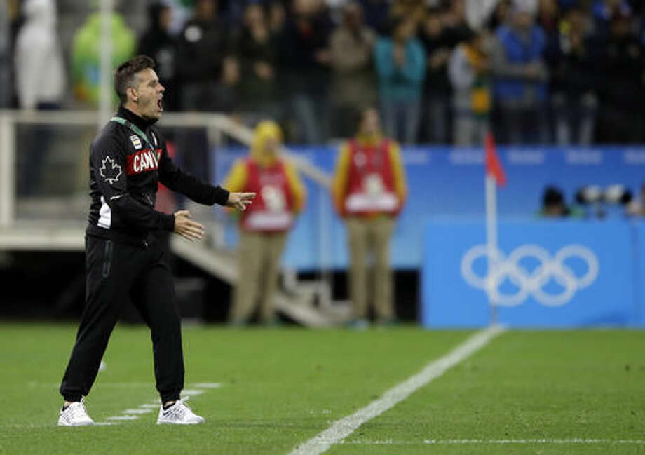 Canada coach John Herdman, left, shouts during a quarter-final match of the women's Olympic football tournament between Canada and France in Sao Paulo, Brazil, Friday Aug. 12, 2016. Canada's won1-0 and went through to the semi-finals.(AP Photo/Nelson Antoine) Photo: Nelson Antoine