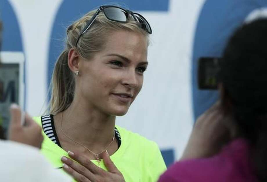 FILE - In this June 20, 2016 file photo, Russia's long jumper Darya Klishina speaks at the national track and field championship in Cheboksary, Russia. Klishina is the only athlete who met the standards when track's governing body, the IAAF, banned the Russian team from the 2016 Summer Olympics in June after an investigation revealed a culture of widespread, state-sponsored doping within the program. (AP Photo/Nikolai Alexandrov, File) Photo: Nikolai Alexandrov