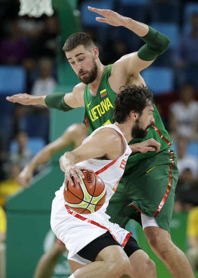 Spain's Sergio Llull tries to drive around Lithuania's Jonas Valanciunas, rear, during a basketball game at the 2016 Summer Olympics in Rio de Janeiro, Brazil, Saturday, Aug. 13, 2016. (AP Photo/Charlie Neibergall) Photo: Charlie Neibergall