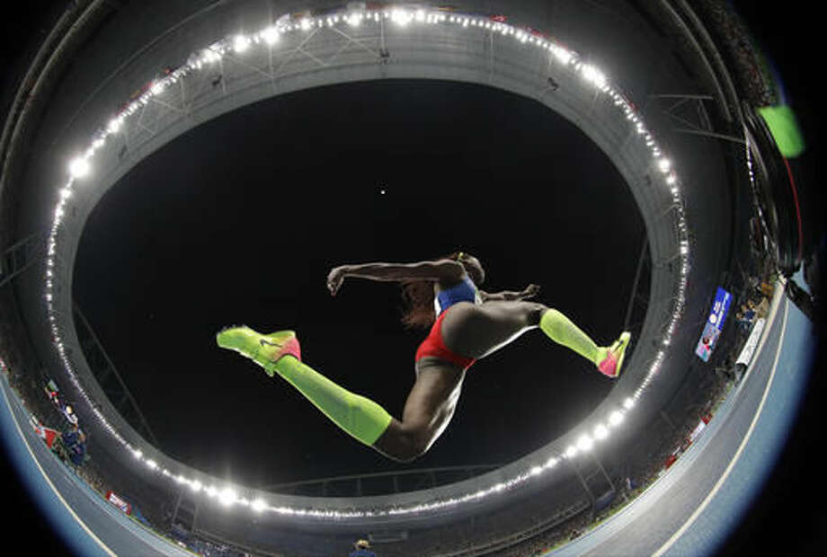 Colombia's gold medal winner Caterine Ibarguen makes an attempt in the women's triple jump final during the athletics competitions of the 2016 Summer Olympics at the Olympic stadium in Rio de Janeiro, Brazil, Sunday, Aug. 14, 2016. (AP Photo/Matt Dunham) Photo: Matt Dunham