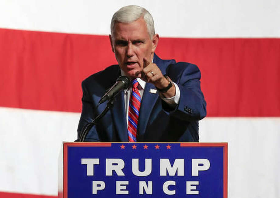 "In this Aug. 8, 2016, photo, Republican vice presidential candidate Indiana Gov. Mike Pence speaks during a campaign stop in Council Bluffs, Iowa. It's been one potentially disastrous misstep after another for Donald Trump this week but you wouldn't know it watching Pence. Trump's running mate is the campaign's happy warrior, avoiding addressing each new eyebrow raising comment the businessman makes while delighting in telling cheering audiences that Trump won't ""tiptoe around"" the rules of political correctness. (AP Photo/Nati Harnik) Photo: Nati Harnik"