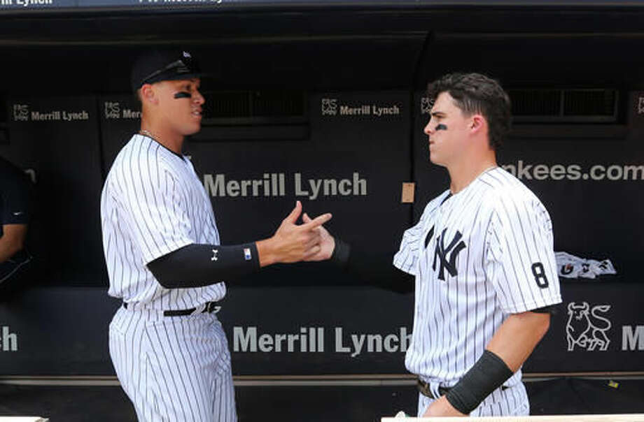 New York Yankees' Aaron Judge, left, and Tyler Austin greet each other in the dugout before their baseball game against the Tampa Bay Rays Saturday, Aug.13, 2016, at Yankee Stadium in New York. (John Munson/The Star-Ledger via AP, Pool) Photo: John Munson