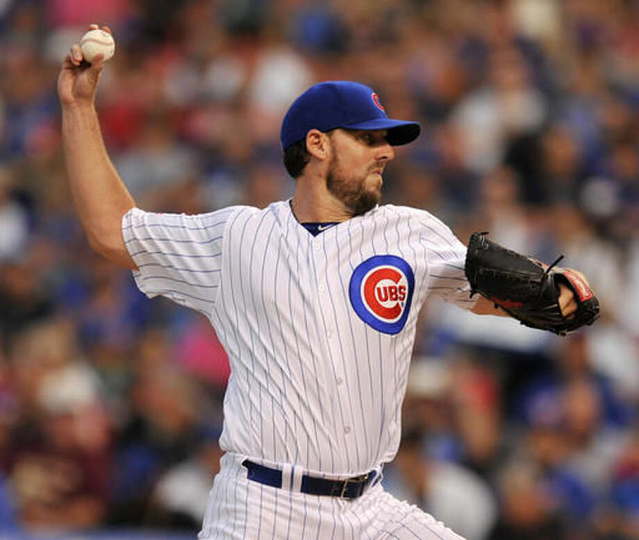Chicago Cubs starter John Lackey delivers a pitch during the first inning of a baseball game against the St. Louis Cardinals, Sunday, Aug. 14, 2016, in Chicago. (AP Photo/Paul Beaty) Photo: Paul Beaty