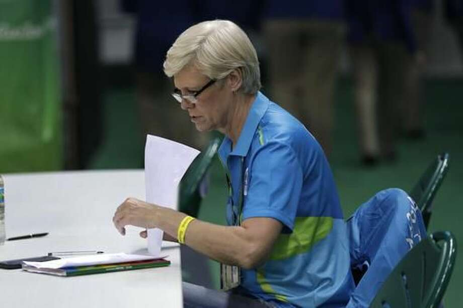 Jill Rankin Schneider looks over notes from the women's basketball game between the United States and China at the Youth Center at the 2016 Summer Olympics in Rio de Janeiro, Brazil, Sunday, Aug. 14, 2016. Rankin Schneider, a member of the U.S. women's basketball team in 1980, missed out on the Olympics in Moscow that year because of a boycott. Now she's finally at her first Olympics, helping track women's basketball for FIBA thanks to an assist from Carol Callan, director of the women's national team for USA Basketball. (AP Photo/Carlos Osorio) Photo: Carlos Osorio