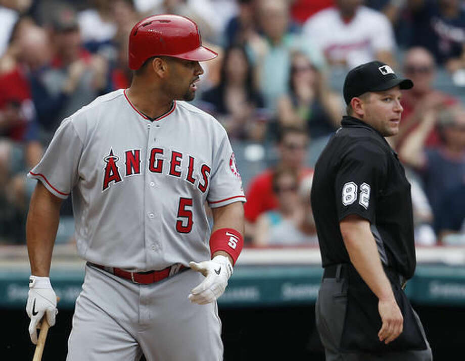 Los Angeles Angels' Albert Pujols, left, argues after being called out on strikes by home plate umpire Clint Fagan, right, during the eighth inning of a baseball game against the Cleveland Indians, Sunday, Aug. 14, 2016, in Cleveland. Pujols was ejected from the game. (AP Photo/Ron Schwane) Photo: Ron Schwane