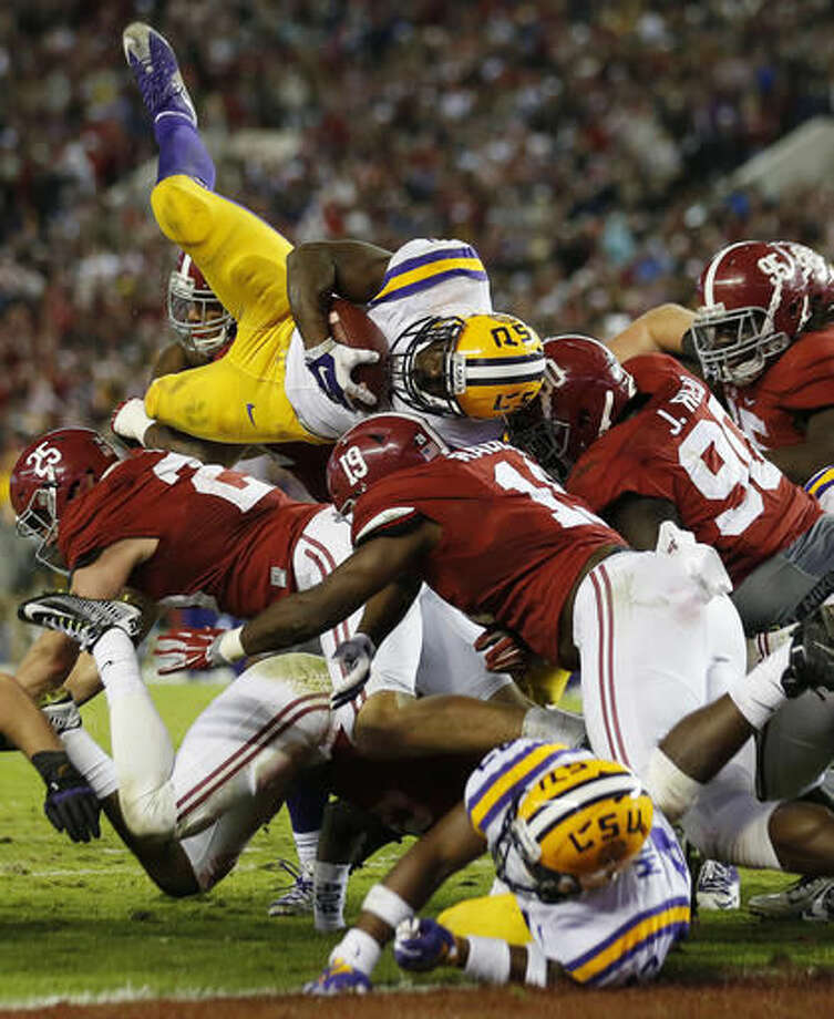 FILE - In this Nov. 7, 2015, file photo, LSU running back Leonard Fournette (7) tries to reach the end zone as the Alabama defense holds at the line in the second half of an NCAA college football game in Tuscaloosa, Ala. No SEC West team has won the division in college football during Nick Saban's time at Alabama without beating the Tide. Can Alabama's defense derail a second consecutive Leonard Fournette Heisman Trophy campaign when the two teams meet on Nov. 5, 2016? (AP Photo/John Bazemore, File) Photo: John Bazemore