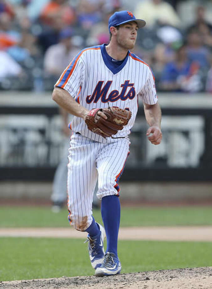 New York Mets starting pitcher Steven Matz reacts as San Diego Padres' Alexei Ramirez breaks up his no-hitter with a single during the eighth inning of the baseball game Sunday, Aug. 14, 2016, in New York. The Mets won 5-1. (AP Photo/Seth Wenig) Photo: Seth Wenig