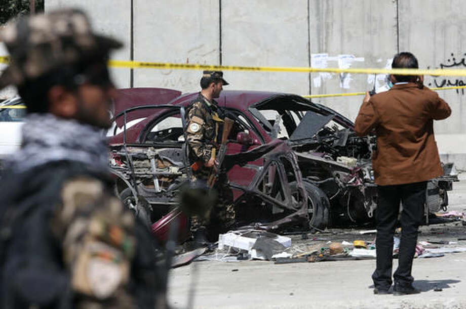 Afghan security personnel inspect the site of an explosion near the U.S. Embassy in Kabul, Afghanistan, Monday, Aug. 15, 2016. Faredoon Obiadi, chief of criminal investigation department of Kabul police said Monday that the target of the attack was an army officer who is among wounded. (AP Photo/Rahmat Gul) Photo: Rahmat Gul