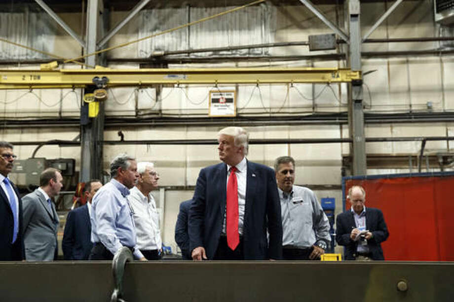 In this Friday, Aug. 12, 2016, photo, Republican presidential candidate Donald Trump takes a tour of McLanahan Corporation headquarters, a company that manufactures mineral and agricultural equipment in Hollidaysburg, Pa. On a Road to 270 that increasingly looks to be uphill climbs and dead ends for Trump in the nation's usual collection of battleground states, the Republican presidential nominee needs a place to reset his Electoral College map. His stops this past week in Michigan and Pennsylvania suggest he's looking at the industrial heartland states on the Great Lakes, a part of the country where he's said he can compete with the Democratic nominee. (AP Photo/Evan Vucci) Photo: Evan Vucci
