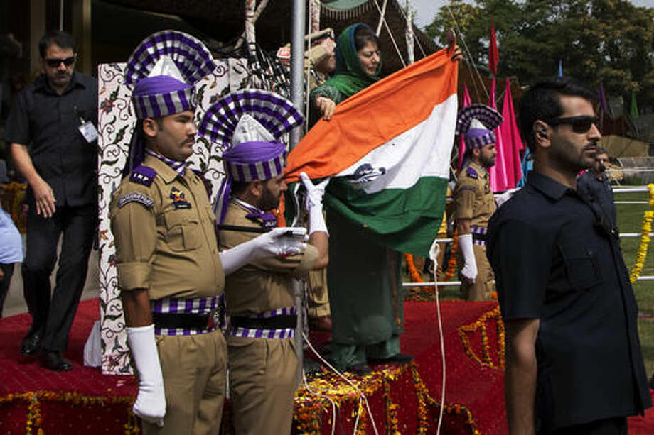 Jammu and Kashmir state Chief Minister Mehbooba Mufti, holds India's national flag after it fell during the unfurling ceremony on India's Independence Day in Srinagar, Indian controlled Kashmir, Monday, Aug. 15, 2016. Authorities ordered a probe to ascertain if it was a sabotage or negligence after India's national flag fell on the top elected official as she pulled the rope to unfurl the flag at the highly guarded soccer stadium. (AP Photo/Dar Yasin) Photo: Dar Yasin