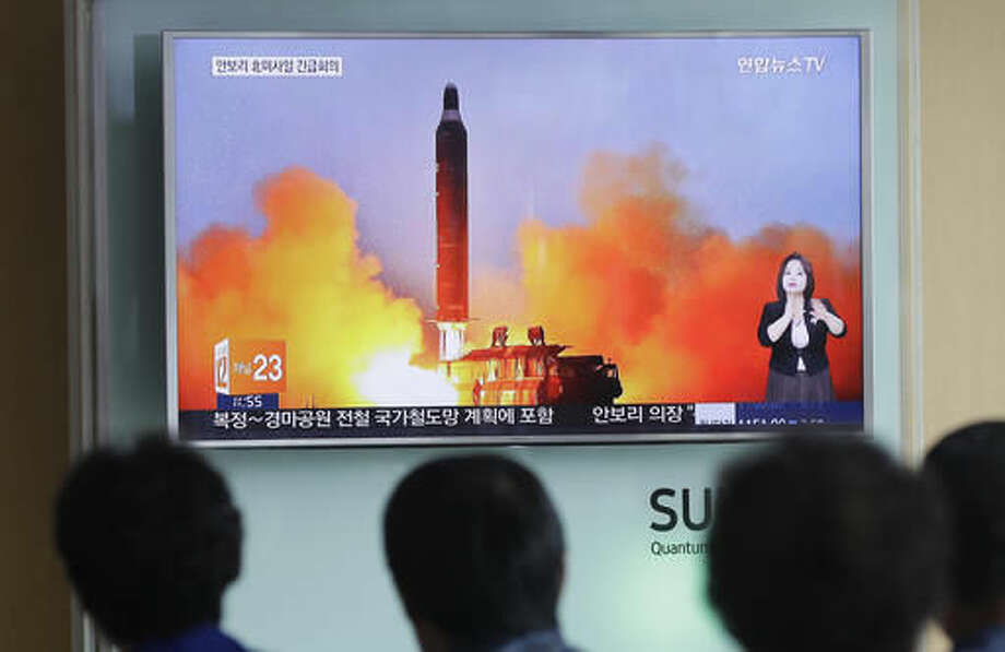 FILE - In this June 23, 2016, file photo, people watch a TV news channel airing an image of North Korea's ballistic missile launch published in North Korea's Rodong Sinmun newspaper at the Seoul Railway Station in Seoul, South Korea. North Korea could soon be capable of targeting America with nuclear weapons. What can the U.S. do to stop it? Diplomacy and economic sanctions have not worked so far. Republican presidential candidate Donald Trump says the U.S. can put more pressure on China to rein in its North Korean ally. Democrat Hillary Clinton wants the world to intensify sanctions as the Obama administration did with Iran, a course that eventually opened the way for a deal to contain its nuclear program.(AP Photo/Ahn Young-joon, File) Photo: Ahn Young-joon