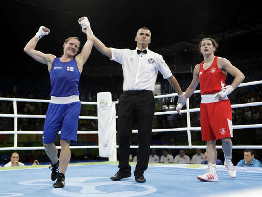 Finland's Mira Potkonen, left, reacts as she won a women's lightweight 60-kg quarterfinals boxing match against Ireland's Katie Taylor at the 2016 Summer Olympics in Rio de Janeiro, Brazil, Monday, Aug. 15, 2016. (AP Photo/Frank Franklin II) Photo: Frank Franklin II