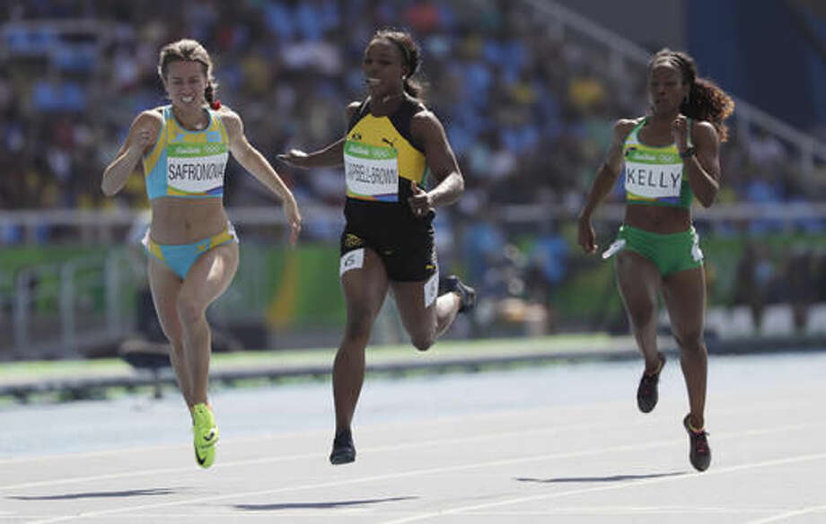 Jamaica's Veronica Campbell-Brown, center, British Virgin Islands's Ashley Kelly, right, and Kazakhstan's Olga Safronova compete in a women's 200-meter heat during the athletics competitions of the 2016 Summer Olympics at the Olympic stadium in Rio de Janeiro, Brazil, Monday, Aug. 15, 2016. (AP Photo/David J. Phillip) Photo: David J. Phillip
