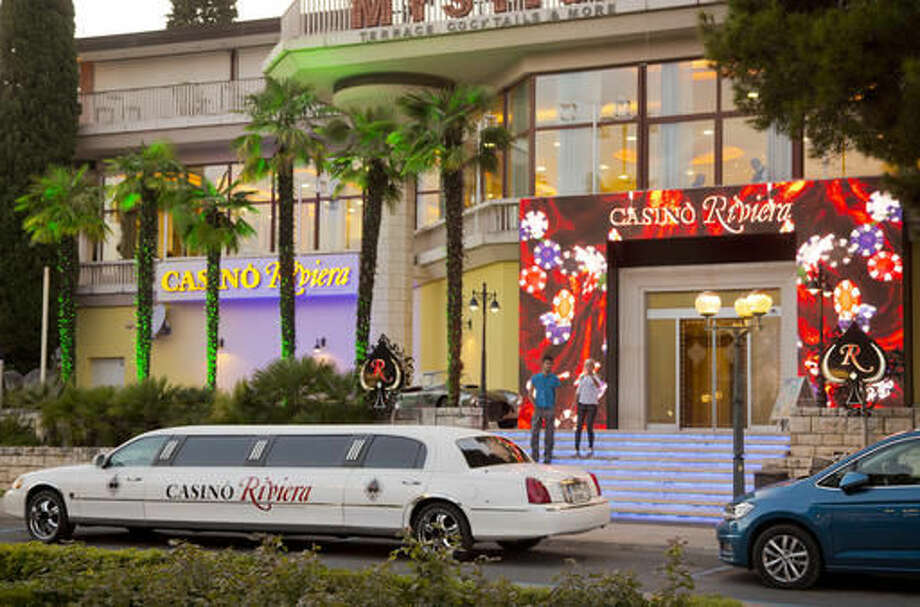 In this Aug. 12, 2016 photo, a limousine is parked in front of a casino in Portoroz, Slovenia. It was in Portoroz in 1992 where Melanija Knavs, who later changed her name to Melania Knauss, got a big break in her modeling career when Slovenia's womens magazine Jana staged its Look of the Year contest. She took second place that gave her the invitation to cast for an international modeling agency in Milan, Italy. (AP Photo/Darko Bandic) Photo: Darko Bandic