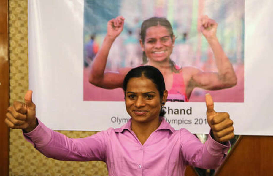 FILE - In this July 9, 2016, file photo, Indian athlete Dutee Chand gestures at a felicitation event in Bangalore, India. The Indian sprinter has qualified for the Olympics after the Court of Arbitration for Sport issued a landmark ruling that challenged her suspension for hyperandrogenism a condition which produces higher than normal testosterone levels in women. (AP Photo/Aijaz Rahi, File) Photo: Aijaz Rahi