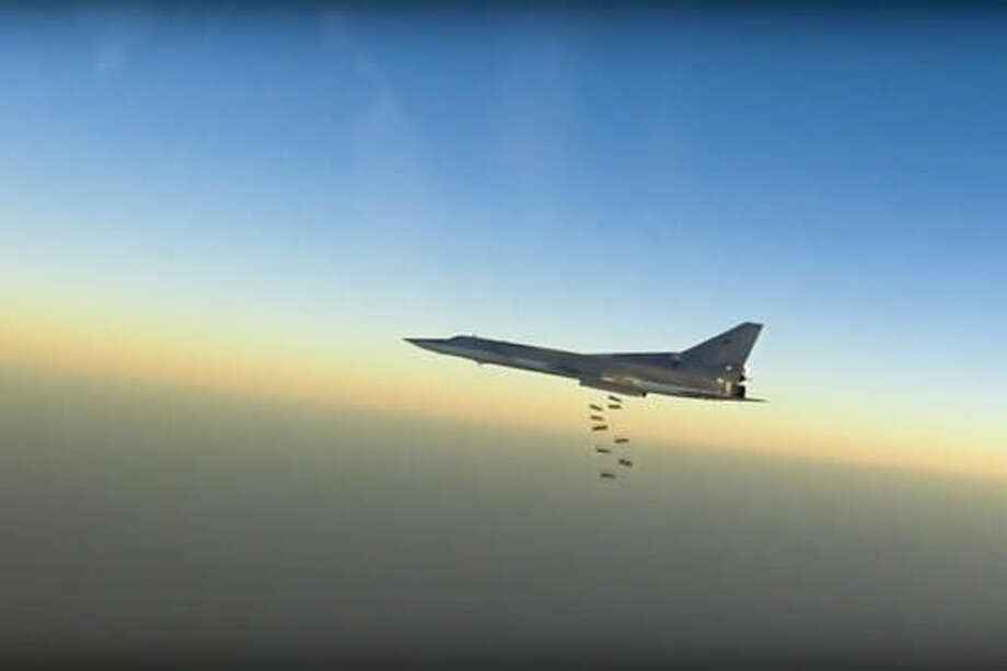 In this frame grab from video provided by the Russian Defence Ministry Press Service, Russian long range bomber Tu-22M3 flies during a strike above an undisclosed location in Syria on Sunday, Aug. 14, 2015. ( Russian Defence Ministry press service photo via AP) Photo: HOGP