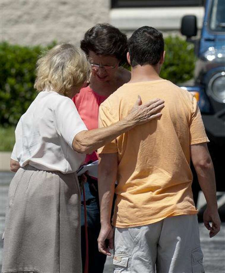 Church members gather outside Hillvue Heights Baptist Church, in Bowling Green, Ky., Sunday, Aug. 14, 2016, after a man allegedly stabbed his father during services. (AP Photo/Daily News, Miranda Pederson) Photo: Miranda Pederson/Daily News