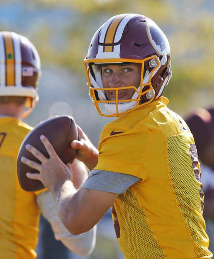 Washington Redskins quarterback Kirk Cousins (8) looks for a receiver during the last day of the Redskins NFL football teams training camp in Richmond, Va., Monday, Aug. 15, 2016. (AP Photo/Steve Helber)