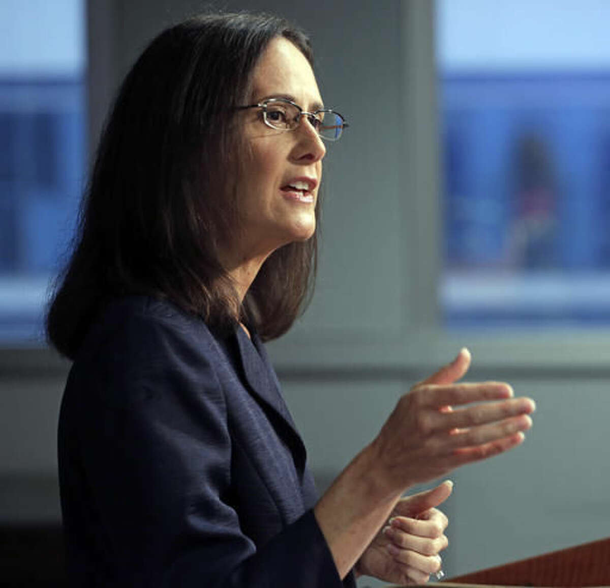 FILE - In this Aug. 21, 2014 file photo, Illinois Attorney Gen. Lisa Madigan speaks at a news conference, in Chicago. Madigan's office has issued an opinion stating that privately transmitted emails about government business are subject to disclosure in a case involving Chicago police officers' discussion of the Laquan McDonald shooting. The binding opinion by Madigan follows quickly on a May Cook County Circuit Court ruling that Chicago Mayor Rahm Emanuel's emails aren't automatically exempt from disclosure even though sent on private devices. (AP Photo/M. Spencer Green, File)