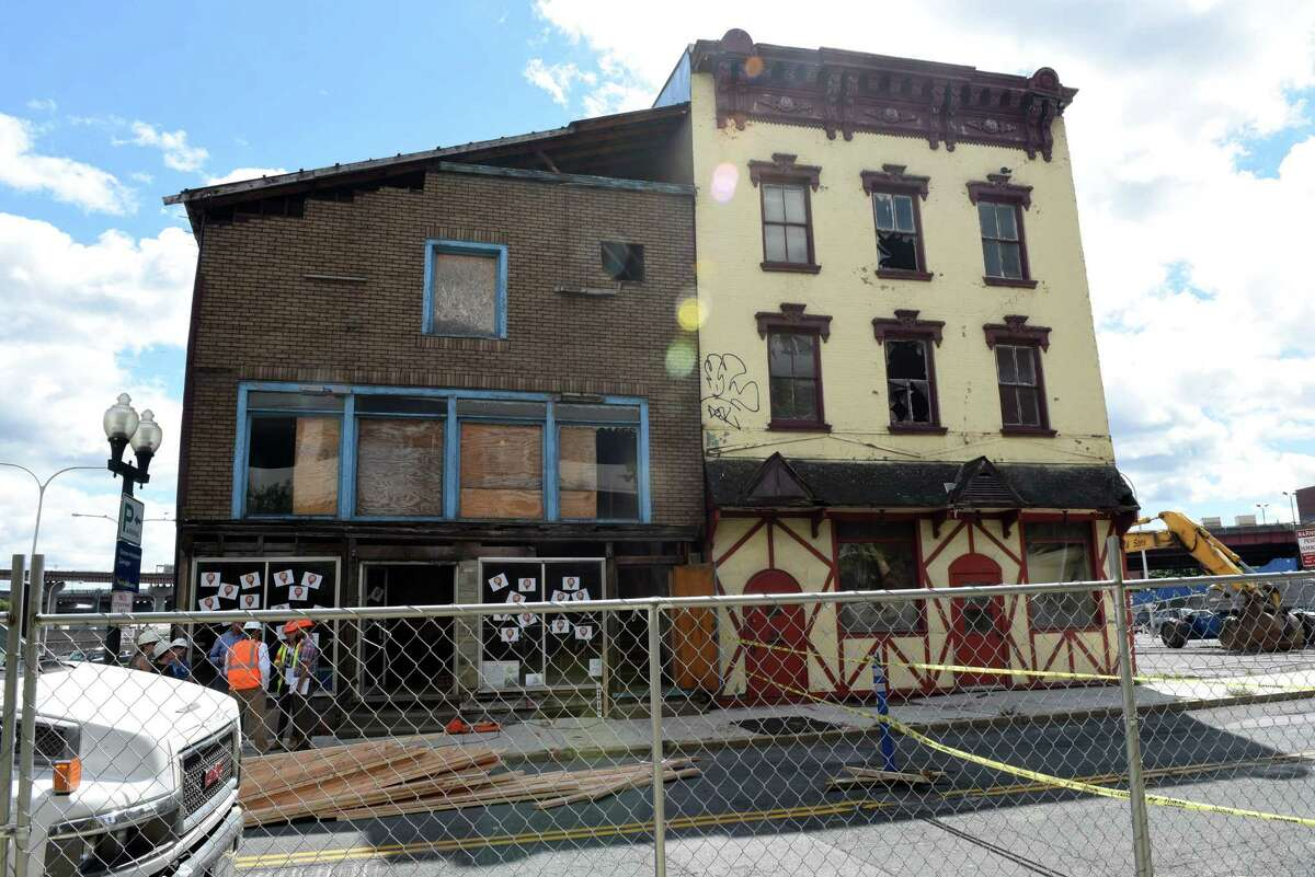 Click through the slideshow to see a few buildings that have come down in the Capital Region this year . The historic building at 48 Hudson Avenue is stabilized before demolition of 50 Hudson is started on Wednesday Aug. 17, 2016 in Albany, N.Y. (Michael P. Farrell/Times Union)