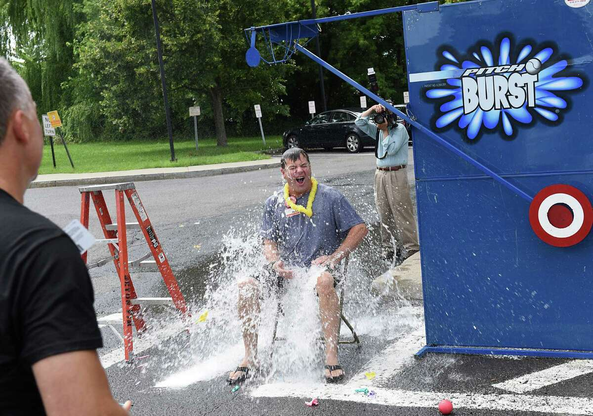 Dr. Daniel Silverman, Chief Medical Officer and Vice President at at St. Peter's Health Partners, gets Norman Dascher, Jr., CEO, Samaritan Hospital and St. MaryOs Hospital, wet after hitting the target at a dunk the CEO event being held during the company picnic at at St. MaryOs Hospital on Wednesday, Aug. 17, 2016 in Troy, N.Y. (Lori Van Buren / Times Union)