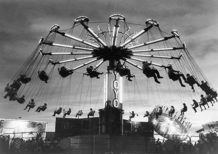 "Fairgoers are treated to a ""swinging"" experience on the YoYo. August 1980 Photo: Midland Daily News File Photo"