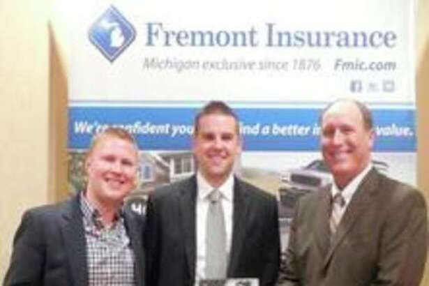 From left, Jake Howard and Brian Holmes with Arbury Insurance and Brad Roeber with Freemont Insurance.