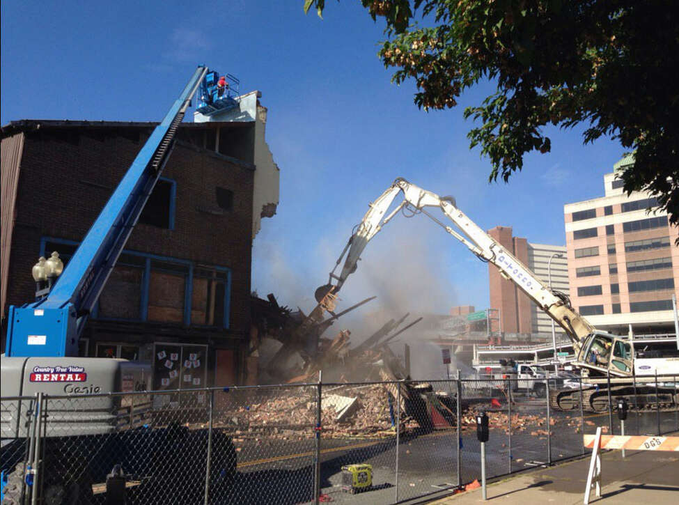 The crumbling structure at 50 Hudson Ave. unexpectedly started to collapse Thursday, Aug. 18, 2016, as workers were preparing to demolish the structure. The historic 1728 Van Ostrande-Radliff House appears unscathed as workers finish the demolition. Paul Buckowski / Times Union