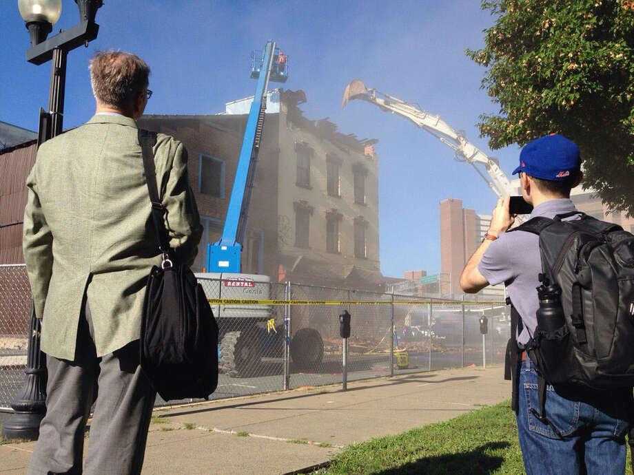 50 Hudson Avenue is demolished on Thursday morning in Albany, N.Y. (Paul Buckowski/Times Union)