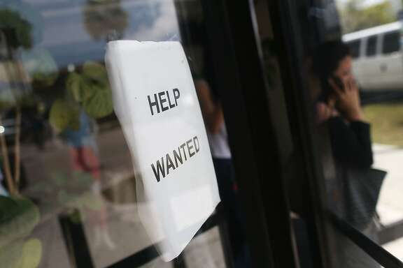 MIAMI, FLORIDA - APRIL 01:  A help wanted sign is seen in the window of a business on April 1, 2016 in Miami, Florida.  U.S. government data released today showed that the economy added 215,000 jobs last month.  (Photo by Joe Raedle/Getty Images)