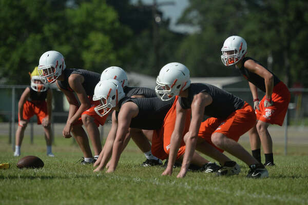 Orangefield players run drills during a recent early morning practice. Photo taken August 02, 2016 Guiseppe Barranco/The Enterprise
