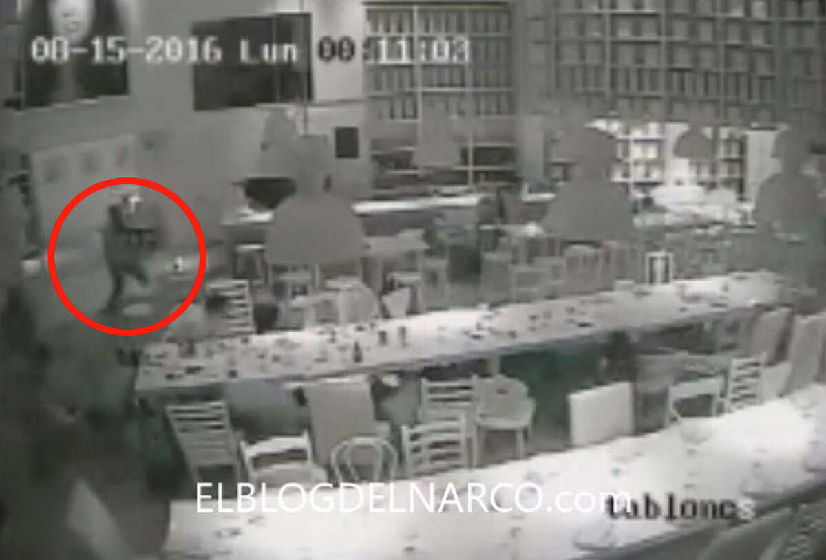 """Guests at the table hit the floor and more gunmen come through the door. Surveillance camera stills posted by Blog del Narco on Wednesday, August 17, 2016, purportedly show the armed abduction of Jesus Alfredo Guzman Salazar, the son of Sinaloa Cartel kingpin Joaquin """"El Chapo"""" Guzman."""