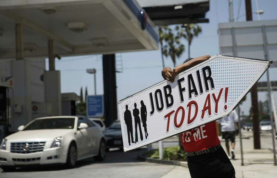 """An Aarrow Sign Spinners representative spins a """"Job Fair Today"""" sign during a Choice Career Fair in Los Angeles, California, U.S., on Wednesday, June 22, 2016. The U.S. Department of Labor is scheduled to release initial jobless claims figures on June 23. Photo: Patrick T. Fallon / Bloomberg / © 2016 Bloomberg Finance LP"""