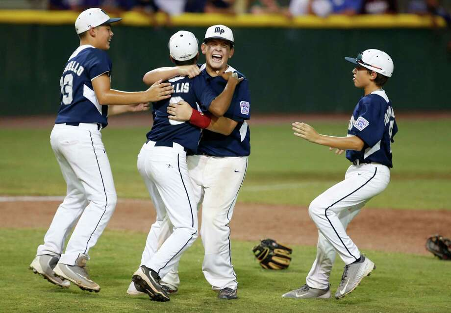 Rilan Quinones (33) of McAllister Park right hugs Dominic Tellis (3) following their win over New Mexico at the Southwestern Little League regional championship game on Aug. 10, 2016, in Waco. Photo: Rod Aydelotte /Waco Tribune-Herald / Waco Tribune Herald